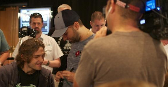 Negreanu surrounded by poker fans and poker media