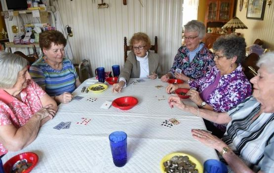 senior women playing poker