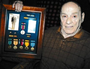 Frank Hoerst Jr. with Navy medals
