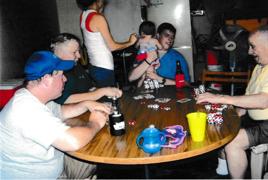 Frank Hoerst Jr. playing cards with family