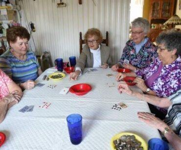 senior women playing poker
