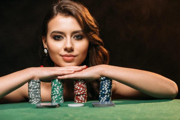 girl resting on poker chips