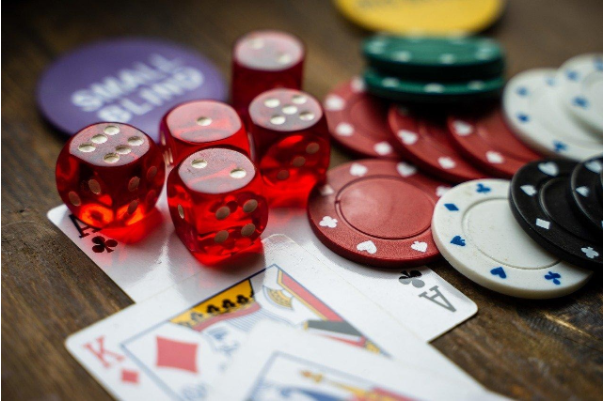 closeup of poker chips, playing cards and dice